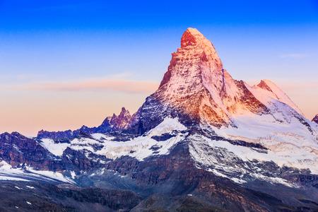 Zermatt, Switzerland. East and north faces of the Matterhorn at sunrise. Stock fotó