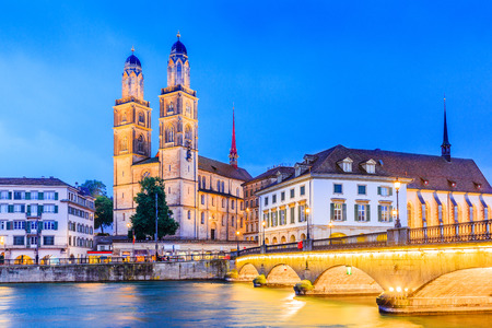 Zurich, Switzerland. View of the historic city center with famous Grossmunster Church, on the Limmat river. Editorial