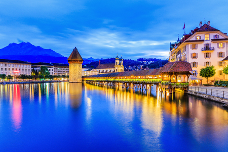 Lucerne, Switzerland. Historic city center with its famous Chapel Bridge and Mt. Pilatus on the background. (Vierwaldstattersee), Stock Photo