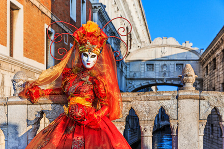 Venice, Italy. Carnival of Venice, beautiful mask at the Bridge of Sighs. Stock Photo - 99178245