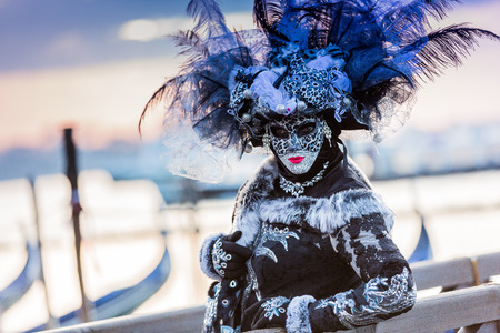 Venice, Italy. Carnival of Venice, beautiful mask at St. Marks Square. Imagens