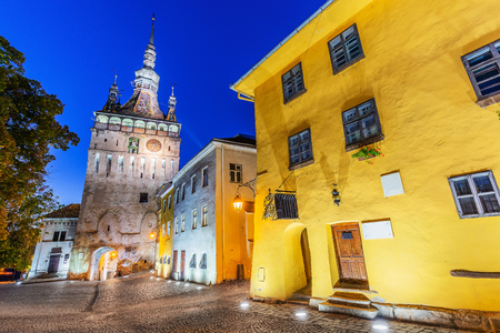 Sighisoara, Romania. Medieval street with Clock Tower and house of Dracula in Transylvania.