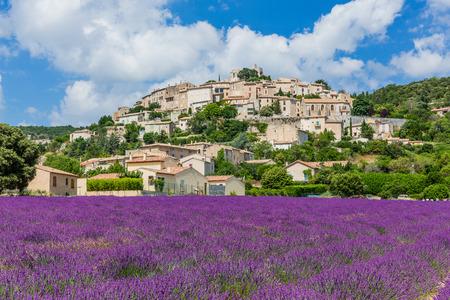 Simiane la Rotonde, France. Hilltop village in Provence with lavender fields.
