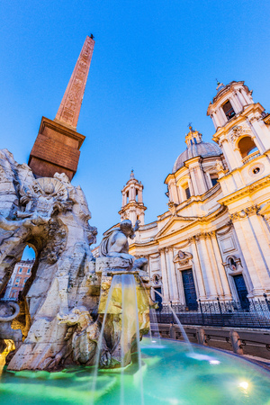 Rome, Italy. The fountain of the four Rivers with Egyptian obelisk at twilight, Piazza Navona.