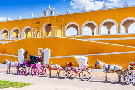 Izamal, Mexico. Convent of Saint Anthony of Padua and horse carriages.