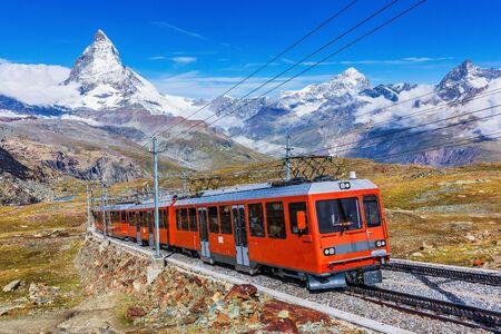 Zermatt, Switzerland. Gornergrat tourist train with Matterhorn peak in the background.