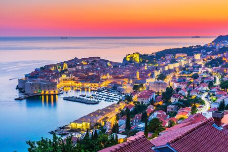 Dubrovnik, Croatia. A panoramic view of the walled city at sunset.