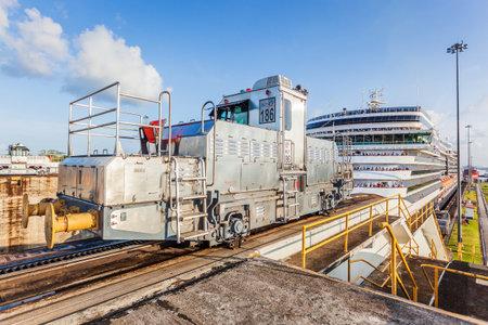 Panama Canal, Panama - April 20, 2011: Ship towed by mule locomotives at Gatun locks. 報道画像