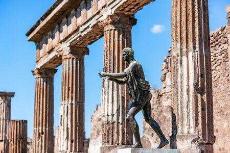 Pompeii, Naples, Italy. Ruins of the antique Temple of Apollo with bronze Apollo statue. 写真素材