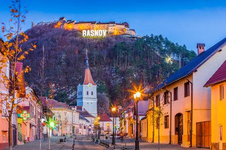 Brasov, Romania. Downtown Rasnov and hilltop fortress.