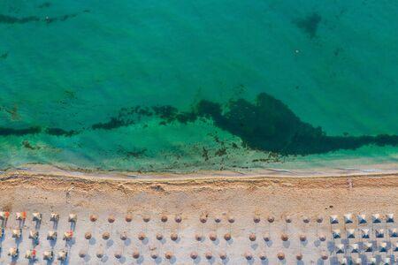 Vama Veche, Romania. Aerial view of Vama Veche beach with umbrellas at the Black Sea.