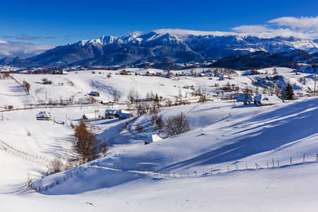 Winter in Pestera Village. Rural landscape in the Carpathians, Romania.