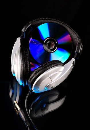 compact disk: Headphones and compact disk with reflection Stock Photo
