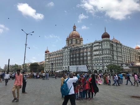 Family taking photograph infront of the Taj Mahal Palace Hotel
