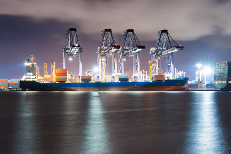 Industrial container freight and containers loading shipping by crane at Trade Port at night Stock Photo