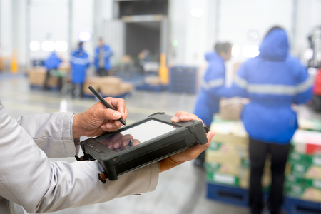 Bluetooth barcode scanner checking goods in warehouse