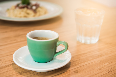 Espresso coffee cup. fresh morning coffee on the wooden table top views concept.