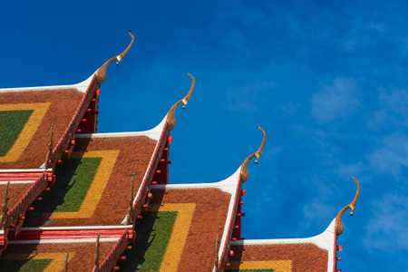 the statue on temple roof in thailand