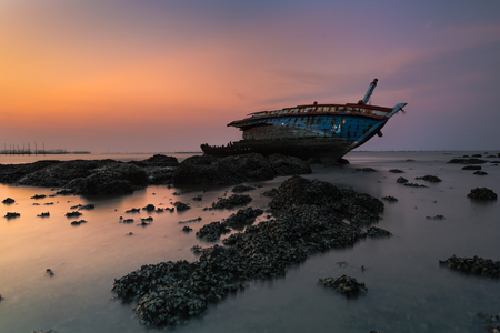 Shipwreck or wrecked boat on beach Stock Photo