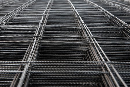Pile of wire mesh. Reinforcement material of concrete pouring. Depth of field concept. Selection focus to texture of material.