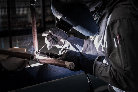 Welding steel pipe with Mig-Mag method for industrial work. Gas metal arc welding
