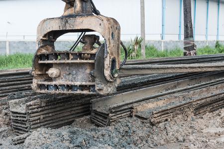 Driving machine work. Retaining wall steel sheet pile materials