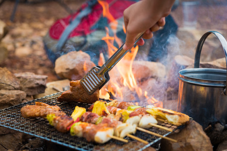 Close up grilling barbecue in the campground at summer camp travel, Skewers of pork and beef fillet on barbecue party in camping, Summer Camp Travel one activity for relaxing.