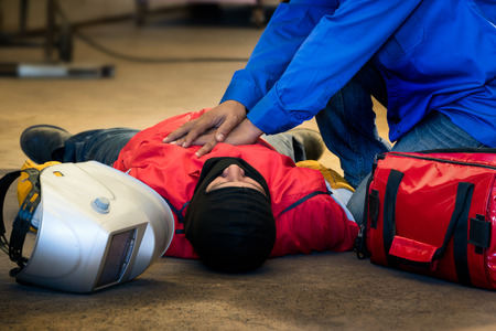 First aid training in the factory industrial. Welder accident in works and fainting in a factory industrial. Safety and protection equipment in works of the construction industry.