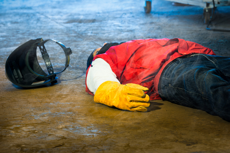 Welder accident in works and fainting in a factory industrial. Safety and protection equipment in works of the construction industry.