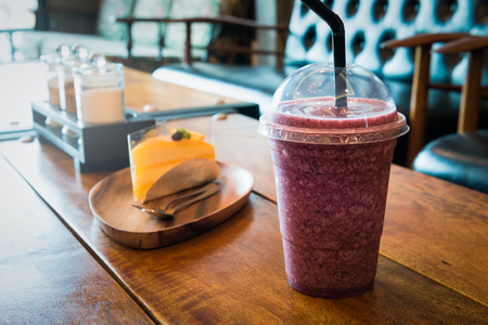 Healthy smoothies cup for weight loss, some healthy food, sweet breakfast on the wooden table in the bakery cafe