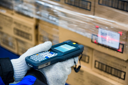 barcode scanner checking goods in the cold room or warehouse