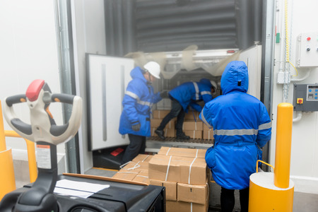 Transporting goods in the loading goods of the freezing warehouse. Storage for Ready-made foods or Ready-to-Eat Foods. Export-Import Logistics system concept. Foto de archivo