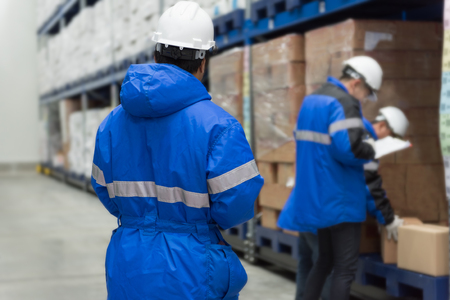 Checking goods in freezing room or warehouse. Storage for Ready-made foods or Ready-to-Eat Foods. Export-Import Logistics system concept. Imagens - 123499497