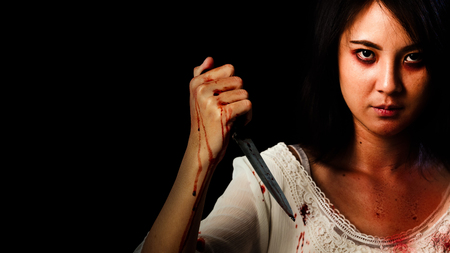Horror photo of Asian girl murderers with knife holding in her hand.