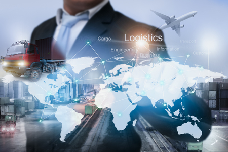 Businessman Pointing to logistics target and technology line on the world map about cargo transportation services idea. Import-Export management for logistics business around the world.