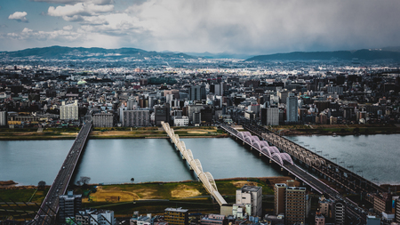 Osaka City view and Yodogawa River in Japan on Floating Garden Rooftop observation area and panorama 360 views of Umeda Sky Building in Japan