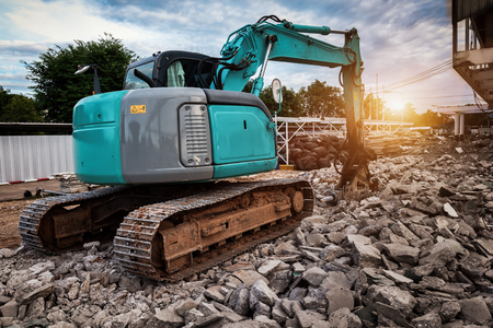 Excavators machine in construction site demolishing existing building for Renovation and new construction project