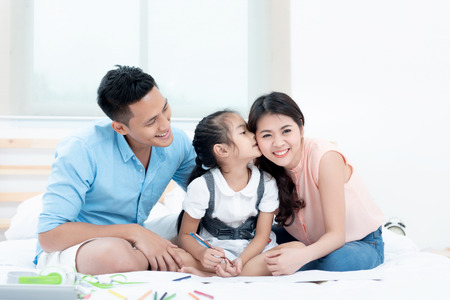 Asian people, Happy family in bedroom at home. Mother, Father and the children playing, Activities of family members are good family health of three people Education of kids, Health Insurance concept. Stok Fotoğraf