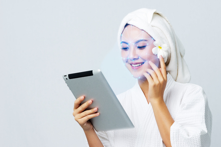 Technological scanning the face of Asian beautiful young woman for facial recognition and Analysis about skin care censor, Ensure personal safety and security in futuristic.