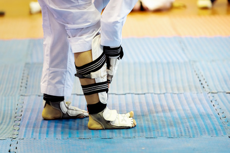 Taekwondo Athlete Slip-On Shin Instep Guards in the stadiums. Moment of Athlete to warm up for strike an opponent during the tournament. Stok Fotoğraf