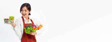 Asian young woman stands to hold vegetables with fresh fruit, Healthy diet. Antioxidant in meal, Risks in food safety, Clean eating food concept with copy space banner.
