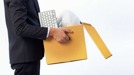 Man holding the office equipment box and his belongings on white background. Termination of employment concept, Unfair dismissal - fair reason for Employee in Job. 版權商用圖片