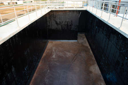 Waterproofing coating paint in Wastewater tank building Imagens