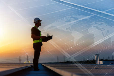 Technician standing on roof checking Photovoltaic cells panels on factory, Maintenance of the solar panels, Engineer service, Inspector concept. Double Exposure Photo.