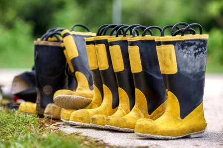 Fire Fighting Rubber Boots, Firefighter Boots of fireman team standing stock prepare for use