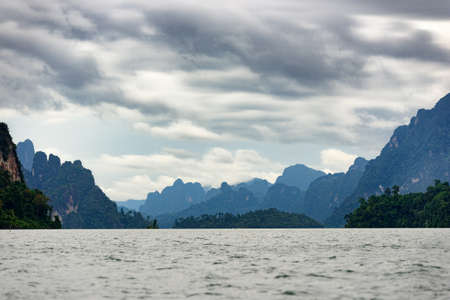 View of Asia lake in the among the islands with mountains and sky in background at Rajjaprabha dam (Chiewlarn dam) at Surat Thani Province of Thailand.