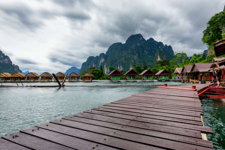 Beautiful scenery of Raft house homestay at lake river in natural attractions with beautiful water reflection.,Ratchaprapha Dam at Khao Sok National Park,Surat Thani Province in Thailand.