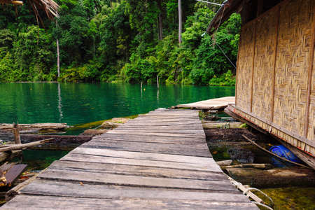 Walkway of Raft house homestay at lake river in natural attractions The need to travel by boat in the Ratchaprapha Dam at Khao Sok National Park, Surat Thani Province in Thailand
