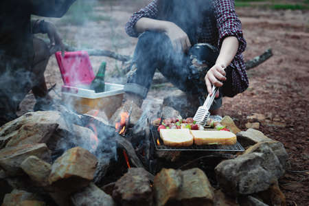 Close up grilling barbecue in the campground at camp travel, Skewers of pork and beef fillet on barbecue party in camping, Summer Camp, Travel one activity for relaxing.