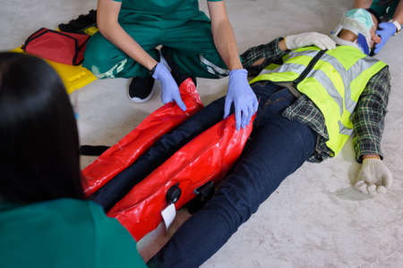 First aid for injuries in work accidents. Using the leg vacuum splint for support to loss of feeling or loss of normal movement and Loss of function in limbs, First aid training to transfer patient.